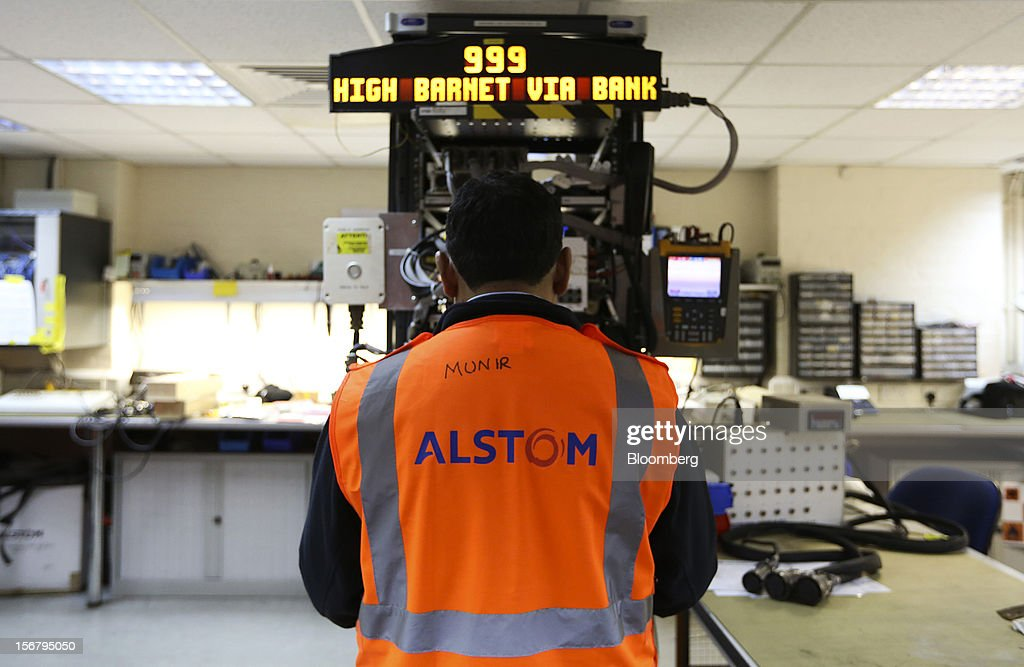An employee tests the electronic destination screens of a London Underground Northern Line train at Alstom SA's Traincare Centre in the Golders Green district of London, U.K., on Wednesday, Nov. 21, 2012. Transport for London (TFL), who oversee the U.K. capital's public transport system, issued 300 million pounds ($476 million) of bonds five months ahead of schedule to take advantage of investor demand as it continues its 35 billion-pound transport investment program. Photographer: Chris Ratcliffe/Bloomberg via Getty Images