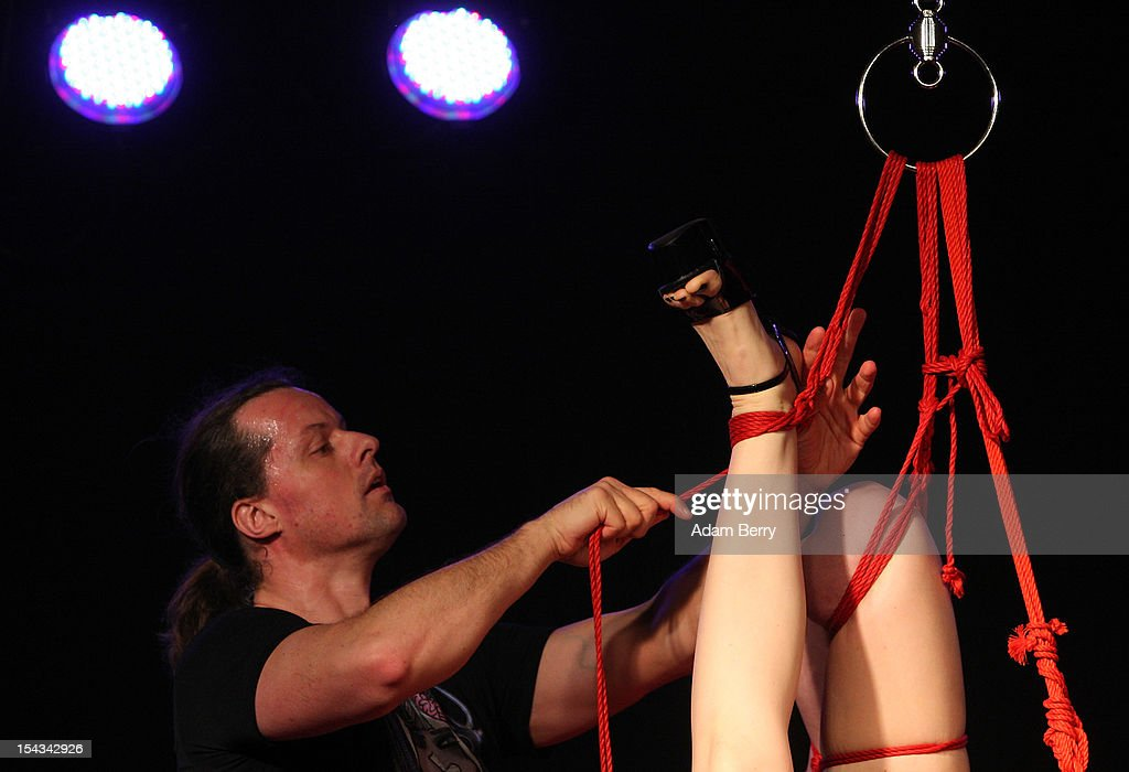 An employee ties up a model during a bondage demonstration at the 2012 Venus Erotic Fair at Messe Berlin on October 18, 2012 in Berlin, Germany. The trade fair for the adult entertainment industry will be open from October 18 through 21.