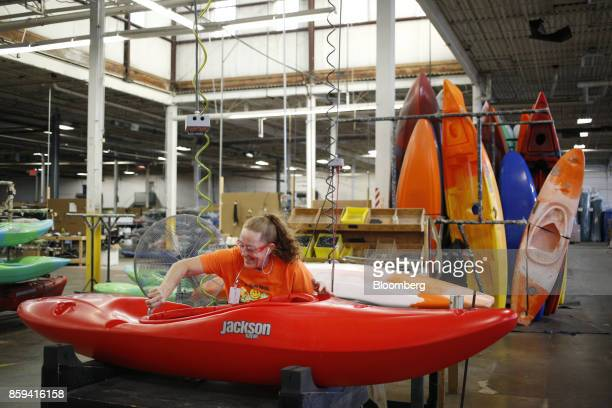 An employee trims the inside of a plastic kayak at the Jackson Kayak Inc factory in Sparta Tennessee US on Wednesday Oct 4 2017 Durable goods orders...