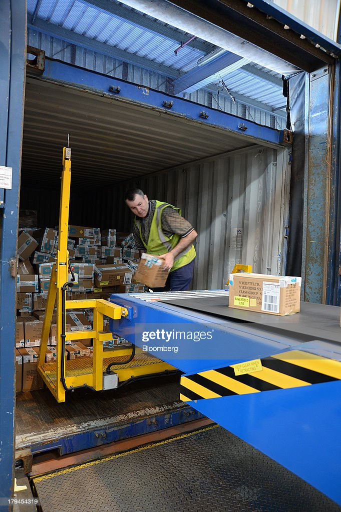 An employee unloads boxes of merchandise onto a conveyor belt at the Myer Holdings Ltd. distribution center in Melbourne, Australia, on Tuesday, Sept. 3, 2013. A Bureau of Statistics report released in Sydney on Sept. 4 showed household spending climbed 0.4 percent in the second quarter, adding 0.2 percentage point to gross domestic product growth. Photographer: Carla Gottgens/Bloomberg via Getty Images