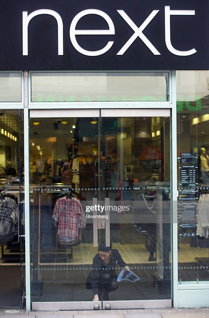 An employee unlocks the glass doors of a Next Plc clothes store in Croydon, south London, U.K., on Monday, Feb. 10, 2014. Westfield Group, Australia's biggest mall operator, and Hammerson Plc won preliminary approval to rebuild the Whitgift Centre mall in south London as part of a project valued at about 1 billion pounds ($1.6 billion). Photographer: Jason Alden/Bloomberg via Getty Images