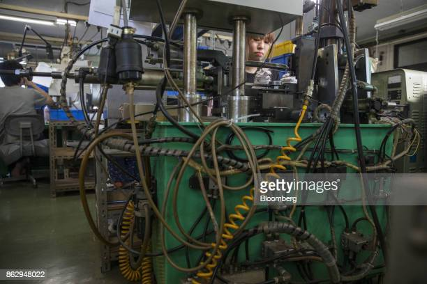An employee use machinery to make an eyeglass temple at a Nagai Co factory in Sabae Fukui Prefecture Japan on Tuesday Oct 10 2017 Fukui Prefecture...