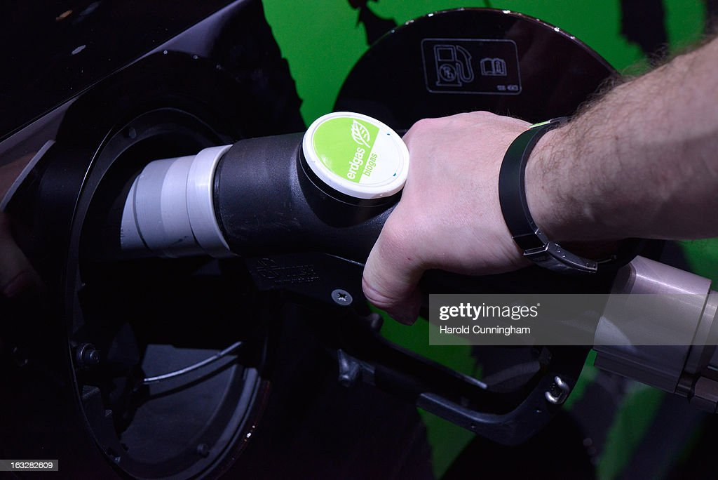 An employee uses a biogas fueling nozzle during the 83rd Geneva Motor Show on March 6, 2013 in Geneva, Switzerland. Held annually with more than 130 product premiers from the auto industry unveiled this year, the Geneva Motor Show is one of the world's five most important auto shows.