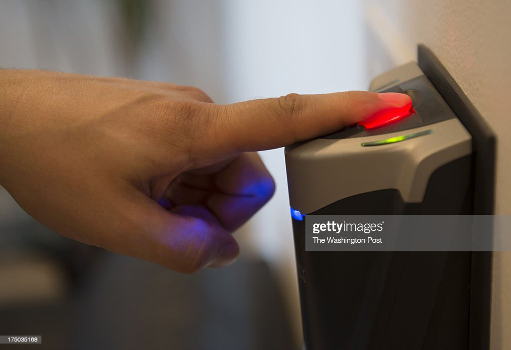 An employee uses a fingerprint verification security device before entering a secured area where medical marijuana is purchased at Capital City Care in Washington, DC on July 29, 2013. The medical marijuana business, located at 1334 N. Capitol Street NW, is is the first to open for legal sale of medical marijuana in the nation's capital. Buyers must have a district issued-photo ID to purchase different grades of the substance. The store also sells paraphenalia for ingesting the substance.