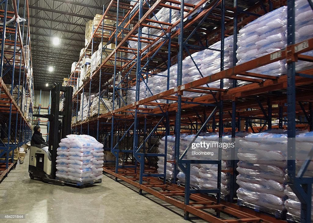 An employee uses a forklift to move a pallet of bagged ice in the cooler at the Capital City Ice facility in Columbus Ohio US on Tuesday Aug 2014 The...