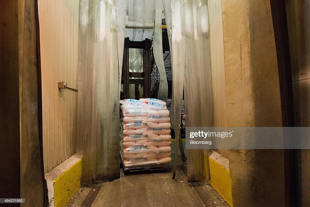 An employee uses a forklift to move a pallet of bagged ice in the cooler at the Capital City Ice facility in Columbus, Ohio, U.S., on Tuesday, Aug, 26, 2014. The Institute for Supply Management (ISM) is scheduled to release U.S. manufacturing figures on Sept. 2. Photographer: Ty Wright/Bloomberg via Getty Images