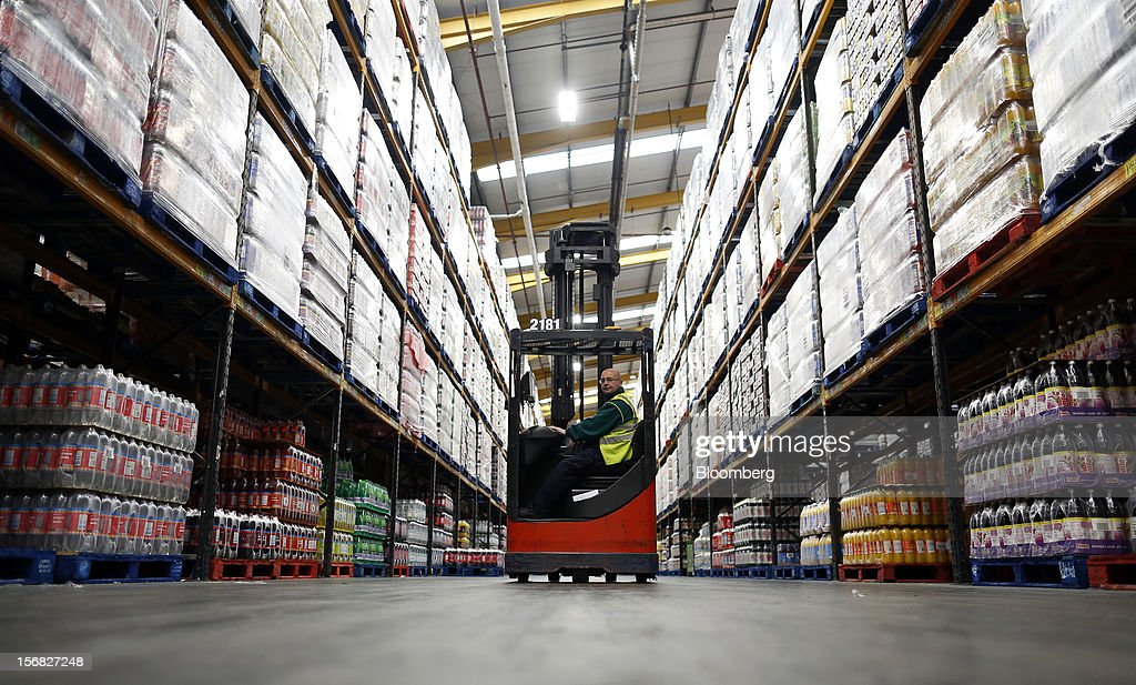 An employee uses a Linde AG forklift to collect goods inside WM Morrison Supermarkets Plc's distribution center in Wakefield, U.K., on Thursday, Nov. 22, 2012. Britain's economy will return to growth next year after stagnating in 2012, with expansion weighted in the second half, according to Bank of England projections published yesterday. Photographer: Simon Dawson/Bloomberg via Getty Images