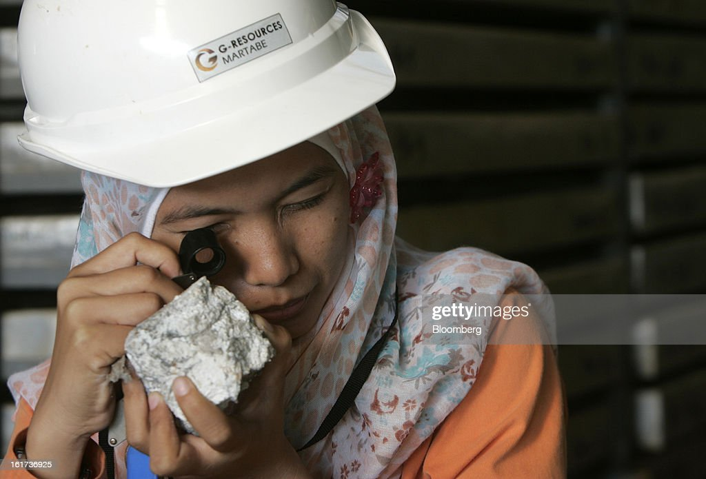 An employee uses a loupe to inspect drill core samples in the core shed at the G-Resources Group Ltd. Martabe gold and silver mine in Batang Toru, North Sumatra province, Indonesia, on Wednesday, Feb. 13, 2013. G-Resources is scheduled to announce financial results on Feb. 28. Photographer: Dadang Tri/Bloomberg via Getty Images