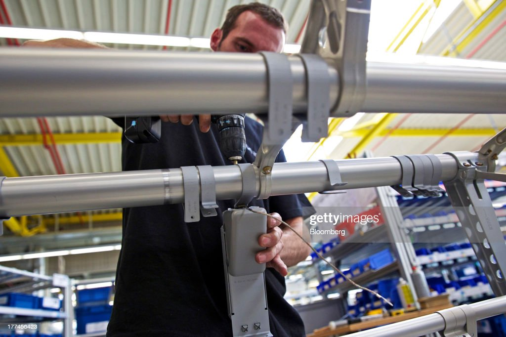 An employee uses a power tool as he works on metal seat frames for Recaro CL3510 economy class aircraft seats on the production line inside Recaro Aircraft Seating GmbH & Co.'s assembly plant in Schwabish Hall, Germany, on Thursday, Aug. 22, 2013. Germany's economic growth in the second quarter was driven by consumption and a rebound in investment as a recovery in the 17-nation euro area, its biggest trading partner, bolstered confidence. Photographer: Gianluca Colla/Bloomberg via Getty Images
