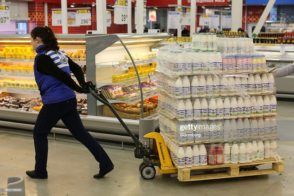 An employee uses a trolley to move a pallet of milk bottles through the aisles of a Lenta LLC supermarket in Prokopyevsk, Kemerevo region, Russia, on Wednesday, March 6, 2013. Lenta LLC, a Russian hypermarket operator controlled by TPG Capital, is selling its first bond to expand after using company funds for a leveraged buyout by the U.S. firm. Photographer: Andrey Rudakov/Bloomberg via Getty Images