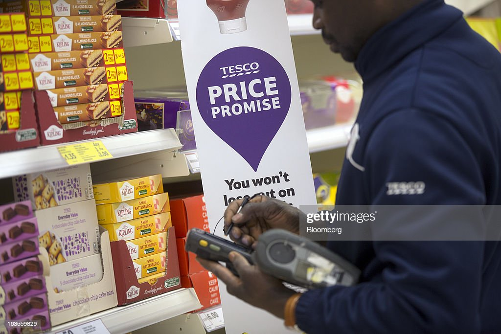An employee uses an electronic handheld device as he checks stock inside a Tesco Plc supermarket in the borough of Kensington in London, U.K., on Tuesday, March 12, 2013. Tesco Plc, the U.K.'s largest grocer launched a 'Price Promise', its latest initiative offering to match the price of customers' purchases to that of it's rivals, including Wal-Mart Stores Inc.'s ASDA. Photographer: Simon Dawson/Bloomberg via Getty Images