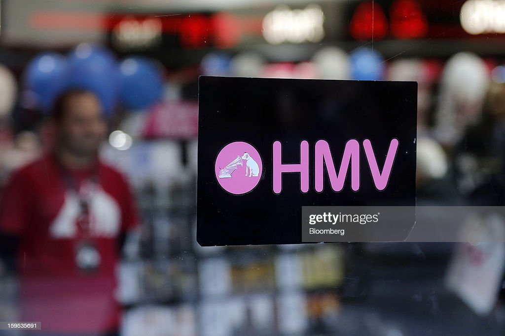 An employee waits to help customers inside an HMV store in London, U.K., on Tuesday, Jan. 15, 2013. Endless LLP, a private-equity firm that focuses on companies in distress, contacted HMV Group Plc's prospective administrators with a view to buying the U.K.'s biggest retailer of CDs and DVDs. Photographer: Simon Dawson/Bloomberg via Getty Images