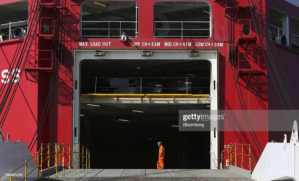 An employee walks across the entrance to the cargo deck of the 'Silverstone Express' vehicle carrier at the port of Koper, operated by Luka Koper d.d., in Koper, Slovenia, on Thursday, May 9, 2013. The former Yugoslav nation, mired in its second recession since 2009, will contract this year and next, according to a May 3 report by the European Commission. Photographer: Chris Ratcliffe/Bloomberg via Getty Images