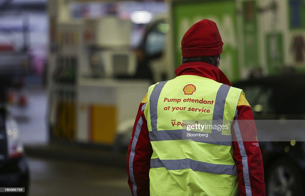 An employee walks across the forecourt of a Royal Dutch Shell Plc gas station in London, U.K., on Tuesday, Jan. 29, 2013. Oil traded near the highest level in four months ahead of a Federal Reserve policy statement that may signal the U.S. central bank will take additional steps to stimulate the economy. Photographer: Chris Ratcliffe/Bloomberg via Getty Images