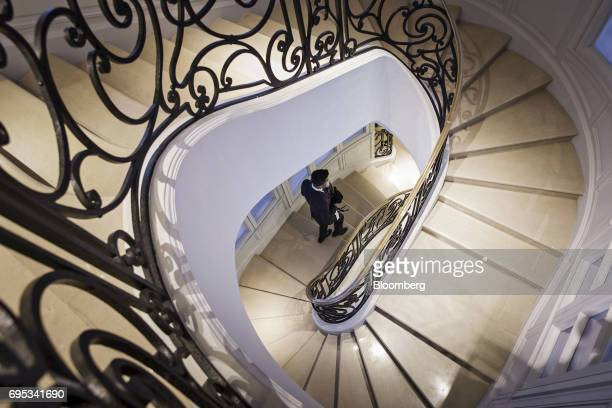 An employee walks down a flight of stairs inside a Christian Dior SE store in Shanghai China on Saturday June 10 2017 Christian Dior SE Chief...
