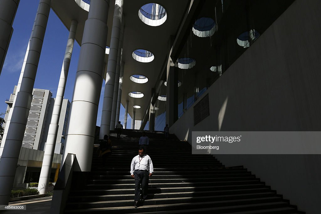 An employee walks down a staircase outside a building in the Wipro Ltd. campus in Bangalore, India, on Tuesday, Jan. 28, 2014. Worldwide spending on information technology will grow 3.1 percent to $3.8 trillion this year, with IT services set to climb 4.5 percent, researcher Gartner Inc. forecast Jan. 6. Photographer: Vivek Prakash/Bloomberg via Getty Images