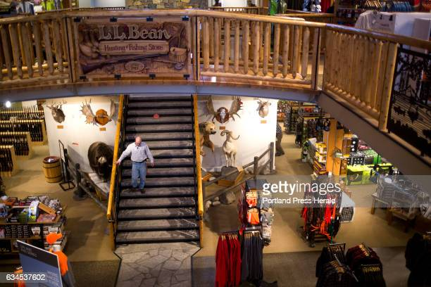 An employee walks down the staircase in the Hunting and Fishing store at the flagship LL Bean store LL Bean is offering early retirement packages to...