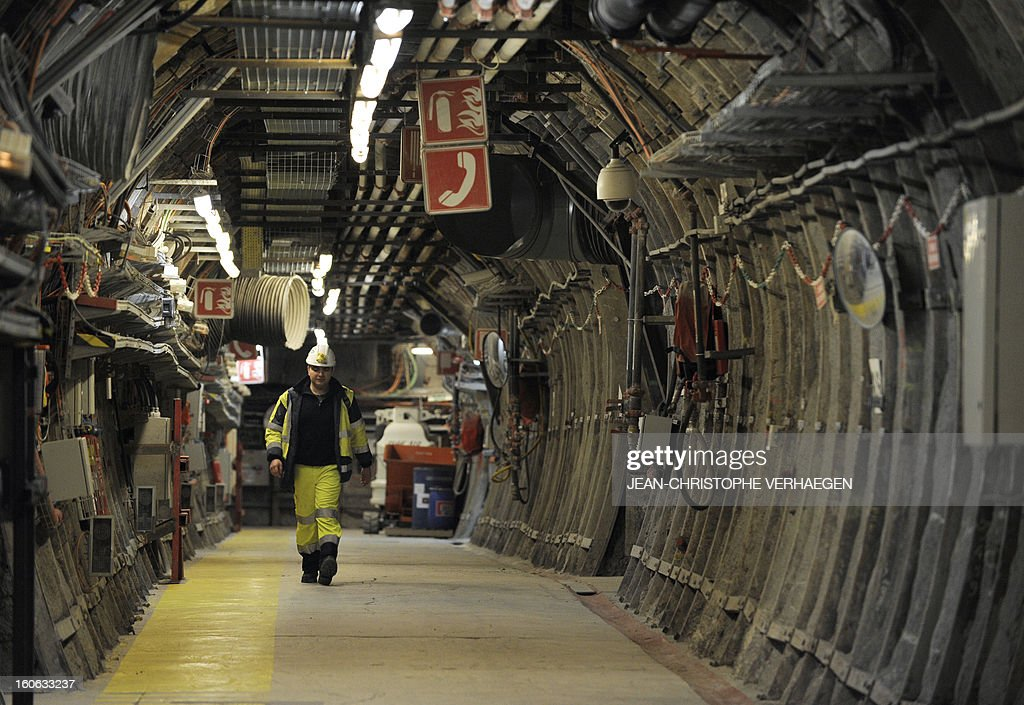An employee walks in a corridor at the Underground Laboratory at Bure, eastern France, operated by the French National Radioactive Waste Management Agency (Andra), on February 4, 2013. AFP PHOTO / JEAN-CHRISTOPHE VERHAEGEN