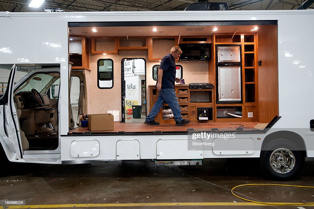 An employee walks inside a Class C motorhome under construction at Nexus RV in Elkhart, Indiana, U.S., on Friday, Feb. 8, 2013. Orders placed with U.S. factories increased less than forecast in December, reflecting a drop in non-durable goods that partly countered gains in construction equipment and computers. Photographer: Ty Wright/Bloomberg via Getty Images