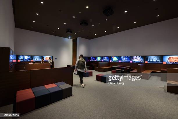 An employee walks inside 'The Answer Lab' at Fast Retailing Co's Uniqlo City Tokyo office in Tokyo Japan on Friday March 10 2017 Uniqlo owner Fast...