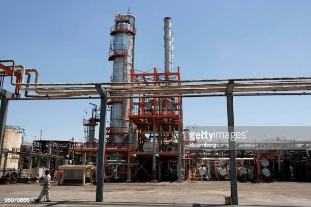 An employee walks inside the Petroleos Mexicanos Miguel Hidalgo oil refinery facility in Tula de Allende Mexico on Thursday March 25 2010 Pemex Latin...