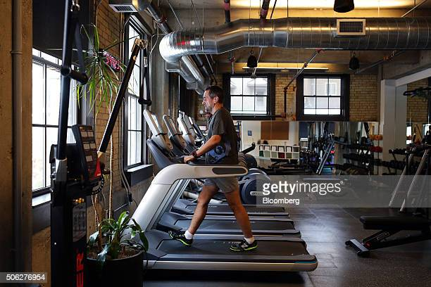 An employee walks on a treadmill in the fitness center at Google Canada's engineering headquarters in Waterloo Ontario Canada on Friday Jan 22 2016...