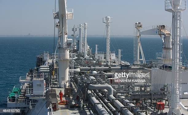An employee walks on the Expedient regasification ship anchored off the coast of Israel in the Mediterranean Sea on February 26 as natural gas began...