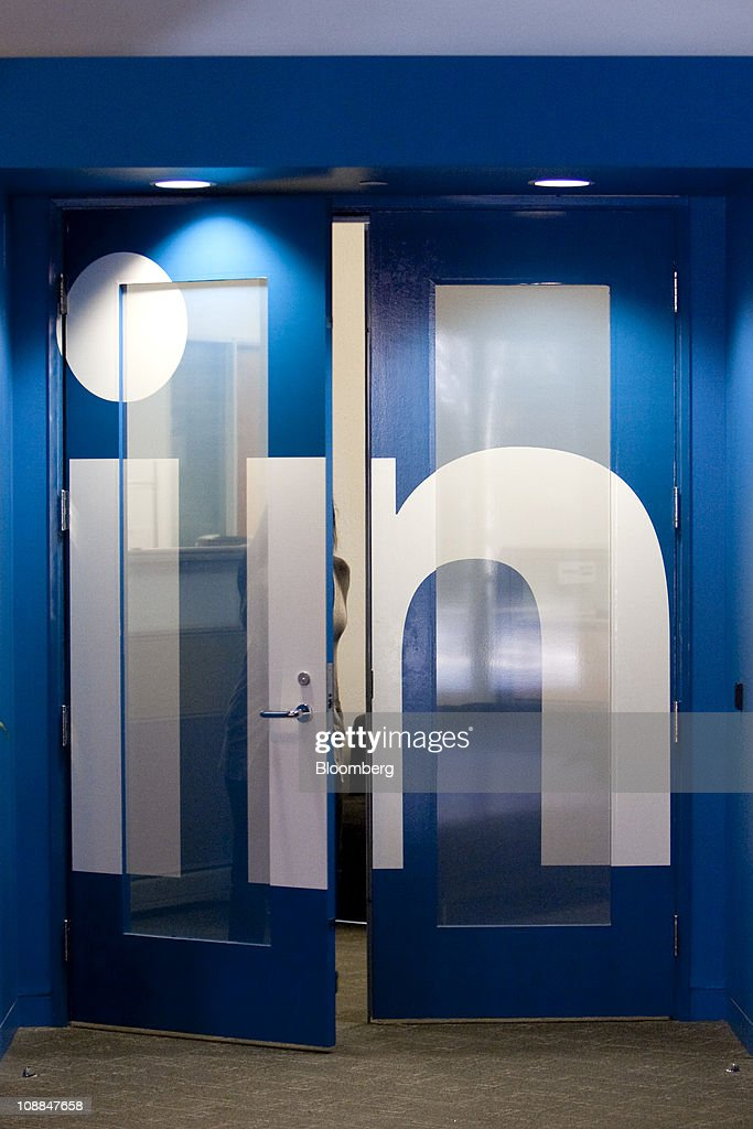 An employee walks out of one of the offices at LinkedIn Corp.'s headquarters in Mountain View, California, U.S., on Thursday, Jan. 27, 2011. LinkedIn Corp., the largest networking website for professionals, said it plans to raise as much as $175 million in an initial public offering. Photographer: David Paul Morris/Bloomberg via Getty Images