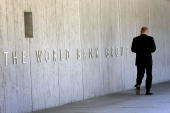An employee walks outside the World Bank headquarters May 8 2007 in Washington DC Recent reports indicate that the global financial institution may...