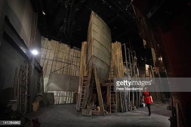 An employee walks past a mock up of the Titanic's hull on the floor of the Shipyard ride at The Titanic Belfast attraction on March 13 2012 in...