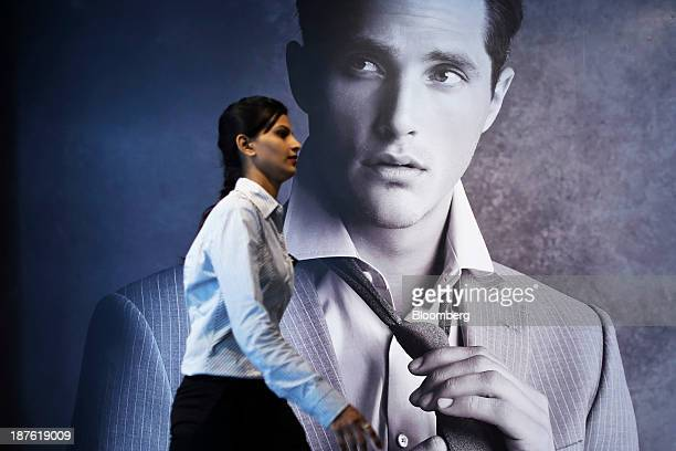 An employee walks past an advertisement inside the new Marks Spencer Reliance India Pvt store in the Bandra area of Mumbai India on Sunday Nov 10...