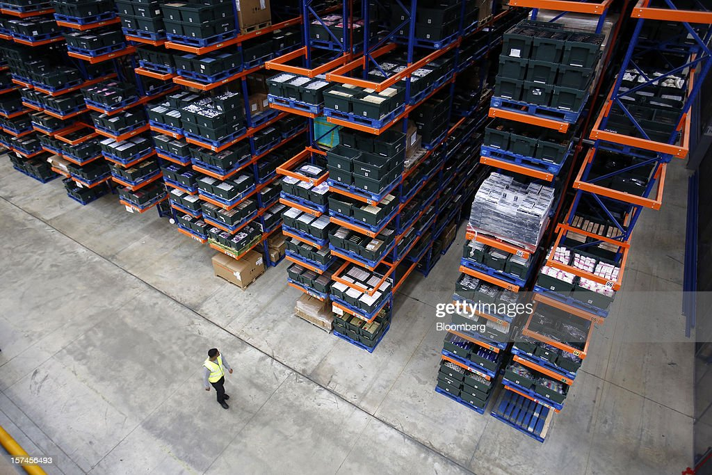 An employee walks past crates of goods stored at the John Lewis Plc distribution centre in Milton Keynes, U.K., on Monday, Dec. 3, 2012. An index of U.K. retail sales rose to a five-month high in November, according to a monthly report from the Confederation of British Industry. Photographer: Simon Dawson/Bloomberg via Getty Images
