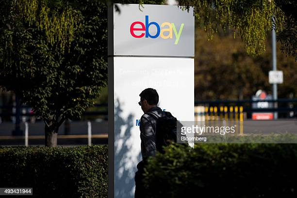 An employee walks past eBay Inc signage displayed at the company's headquarters in San Jose California US on Friday Oct 16 2015 EBay is expected to...