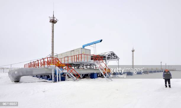 An employee walks past part of the monitoring section at the gas compression facility operated by OAO Gazprom in Sudzha Russia on Thursday Feb 11...