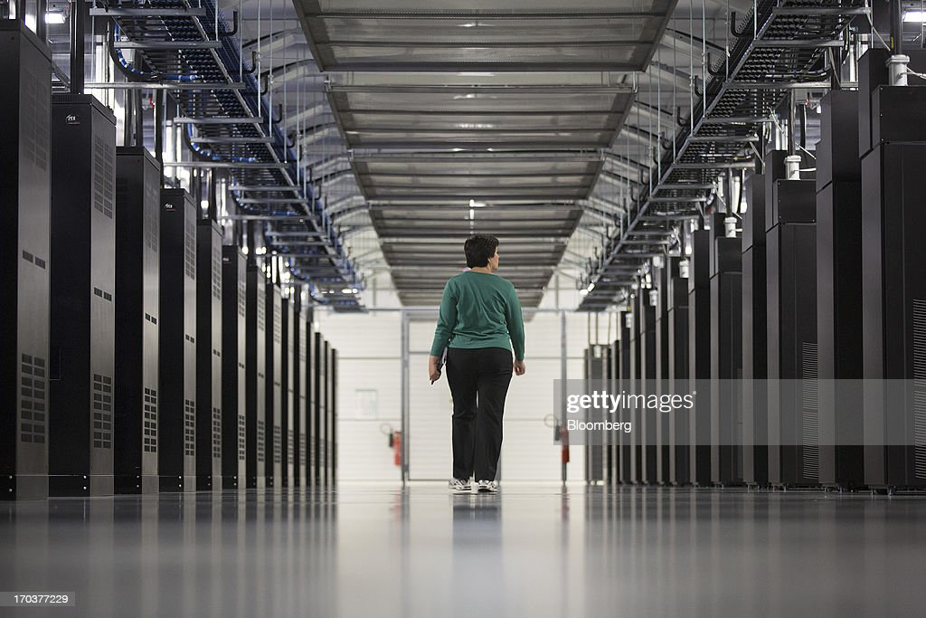 An employee walks past server racks inside Facebook Inc.'s new data storage center near the Arctic Circle in Lulea, Sweden, on Wednesday, June 12, 2013. The data center is Facebook's first outside the U.S., poised to handle all data processing from Europe, Middle East and Africa and the server hub is largest of its kind in Europe, and most northerly of its magnitude anywhere on earth. Photographer: Simon Dawson/Bloomberg via Getty Images