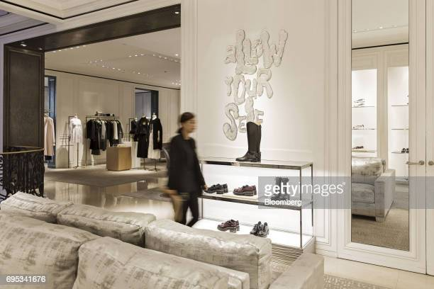 An employee walks past shoes on display inside a Christian Dior SE store in Shanghai China on Saturday June 10 2017 Christian Dior SE Chief Executive...