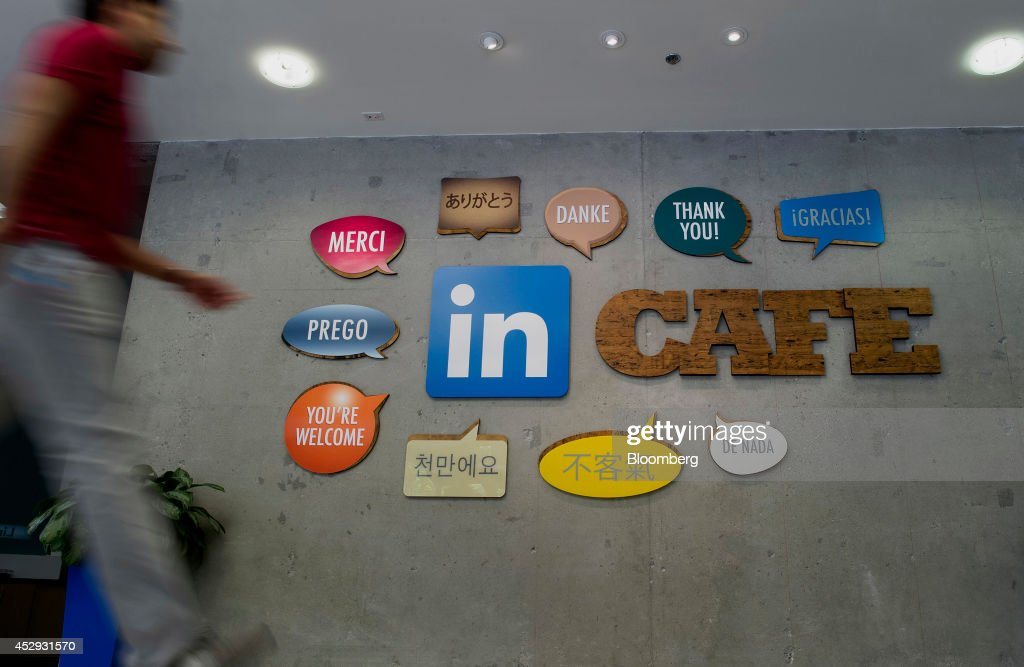 An employee walks past signs displayed on the wall outside one of the lunchrooms at LinkedIn Corp. headquarters in Mountain View, California, U.S., on Monday, July 28, 2014. LinkedIn Corp. is scheduled to release earnings figures on July 31. Photographer: David Paul Morris/Bloomberg via Getty Images