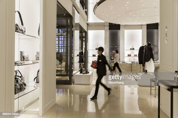An employee walks through a Christian Dior SE store in Shanghai China on Saturday June 10 2017 Christian Dior SE Chief Executive Officer Sidney...