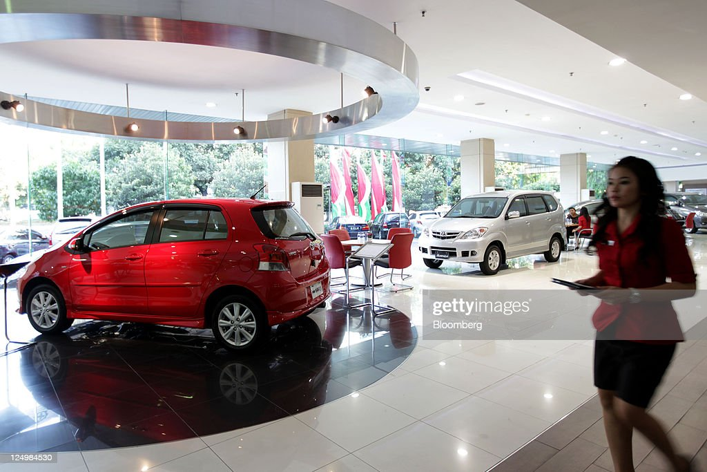 An employee walks through Auto2000 Sudirman, a dealer for PT. Toyota Motor Manufacturing Indonesia, in Jakarta, Indonesia, on Wednesday, Sept. 14, 2011. Toyota Motor Corp., the biggest carmaker in Asia, plans to build a second factory in Indonesia at a cost of 26.3 billion yen ($341 million) to help boost sales in emerging markets. Photographer: Dimas Ardian/Bloomberg via Getty Images