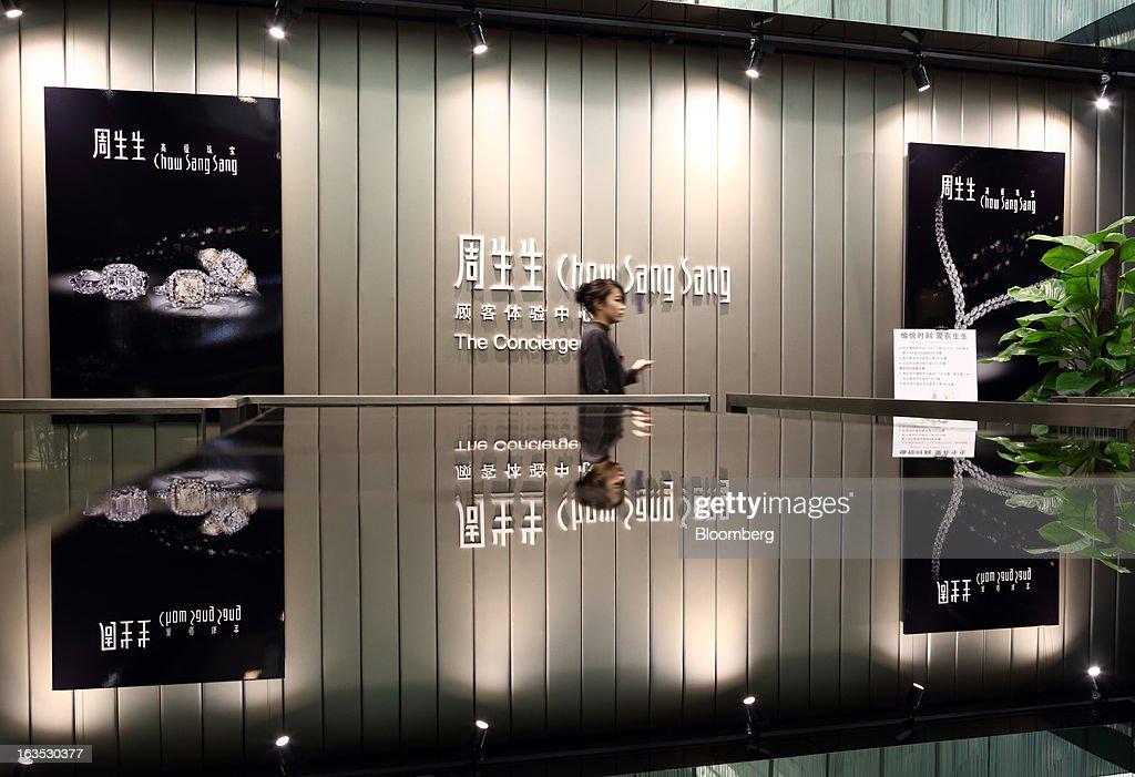 An employee walks through the concierge booth at the Chow Sang Sang Holdings International Ltd. jewelry store in the Sanlitun district of Beijing, China, on Monday, March 11, 2013. China's consumer prices climbed 3.2 percent from a year earlier, according to figures released March 9, exceeding January's 2 percent gain and the median estimate for a 3 percent increase in a Bloomberg survey of analysts. Photographer: Tomohiro Ohsumi/Bloomberg via Getty Images