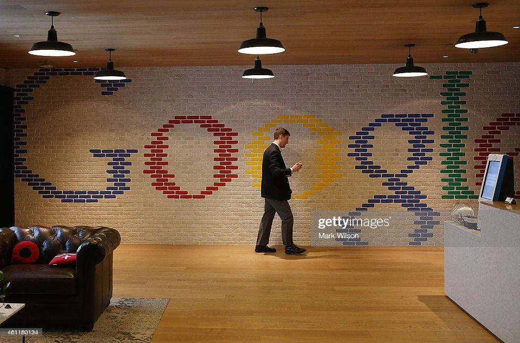 An employee walks through the lobby of Google's Washington headquarters January 8 2015 in Washington DC Google held a news conference with...