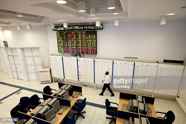 An employee walks through the Nairobi Stock Exchange in Nairobi Kenya on Thursday Feb 25 2010 Kenya National Bureau of Statistics said it will...