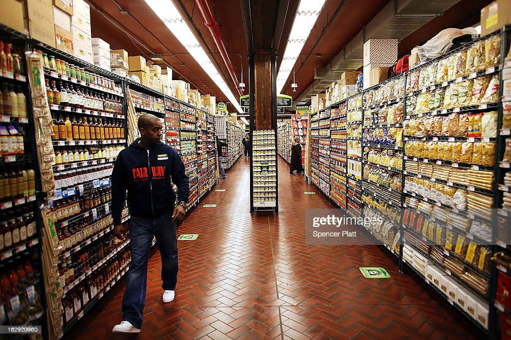 An employee walks through the newly re-opened Fairway Market on the waterfront in Red Hook on March 1, 2013 in the Brooklyn borough of New York City. Fairway, which quickly became a popular shopping destination and an anchor in the struggling community of Red Hook, was closed following severe flooding during Hurricane Sandy on October 29, 2012. Like the rest of Red Hook, Fairway has struggled to quickly re-open in a neighborhood that lost dozens of businesses during the storm. The re-opening, which included a ceremony and ribbon cutting featuring Miss America and Mayor Michael Bloomberg, is being trumpeted as the Red Hook neighborhood's official comeback since the storm.