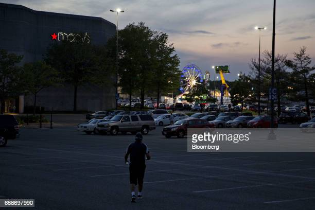 An employee walks through the parking lot during the Dreamland Amusements carnival in the parking lot of the Marley Station Mall in Glen Burnie...