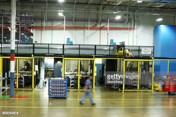 An employee walks through the SEWEurodrive Inc production facility in Lyman South Carolina US on Friday June 23 2017 Productivity in the US rose...
