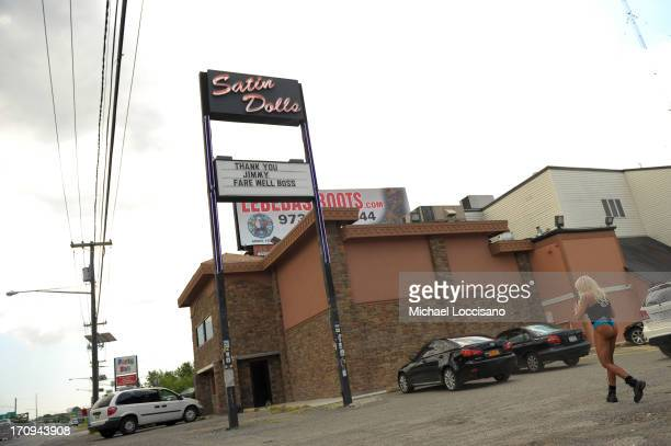 An employee walks toward Satin Dolls the location used for Bada Bing in the filming of 'The Sopranos' June 20 2013 in Lodi New Jersey Gandolfini...