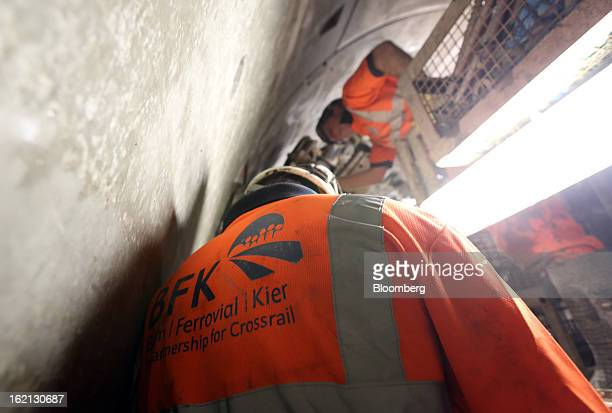 An employee watches as a concrete wall slab is fixed into position inside one of new western tunnels developed by Crossrail beneath London UK on...