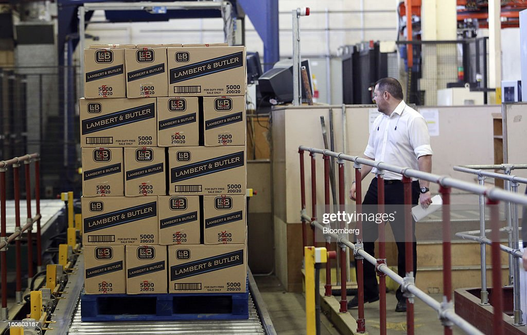 An employee watches as a pallet loaded with Lambert and Butler cigarettes moves along the production line ahead of distribution at Imperial Tobacco Group Plc's factory in Nottingham, U.K., on Friday, Feb. 1, 2013. Imperial Tobacco Group Plc is Europe's second-biggest tobacco company and generates about 40 percent of its profit from the region. Photographer: Chris Ratcliffe/Bloomberg via Getty Images