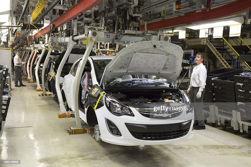 An employee watches as Opel Corsa automobiles move along the production line at the Adam Opel AG factory, operated by General Motors Co. (GM), in Eisenach, Germany, on Wednesday, April 23, 2014. European sales at Opel and its U.K. sister brand Vauxhall gained 8.5 percent to 226,888 cars in the first quarter, slightly better than the 8.1 percent increase for the market overall, according to ACEA data. Photographer: Martin Leissl/Bloomberg via Getty Images