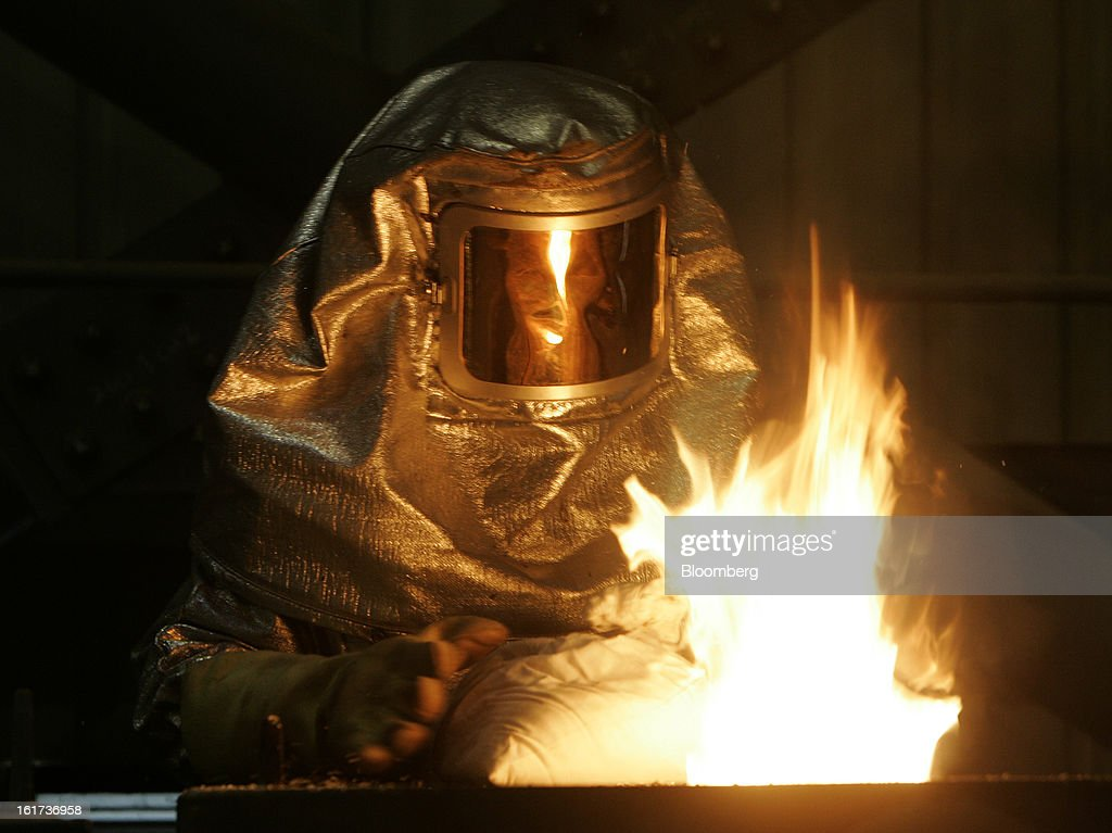 An employee wearing a protective suit works in the smelter inside the processing plant at the G-Resources Group Ltd. Martabe gold and silver mine in Batang Toru, North Sumatra province, Indonesia, on Wednesday, Feb. 13, 2013. G-Resources is scheduled to announce financial results on Feb. 28. Photographer: Dadang Tri/Bloomberg via Getty Images